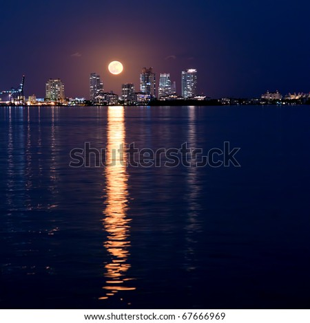 full moon rising over miami south beach on first day of winter, december 2010 - stock photo