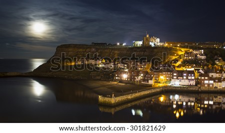 Full moon rising over Whitby - stock photo