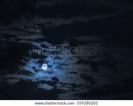 full moon under clouds - stock photo