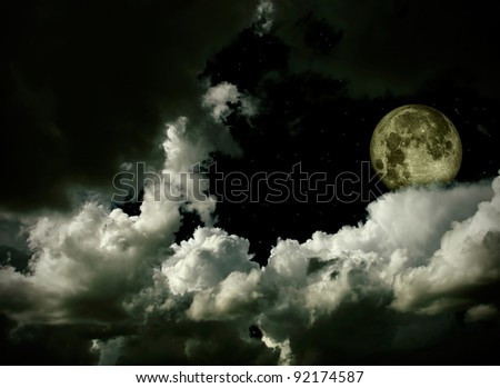 full moon with clouds and stars - stock photo