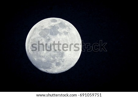 Full moon with dark background.
