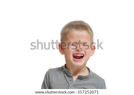 Full of emotions portrait of a seven-years-boy: closed eyes and open mouth laugh. Closeup, isolated