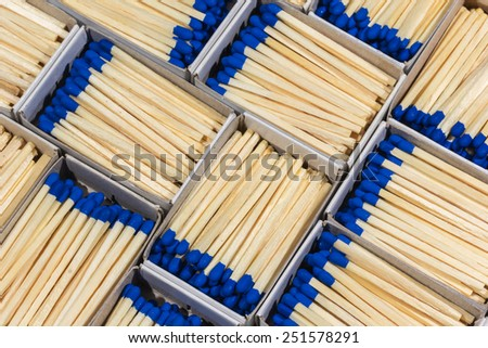 full of matchboxes with matches inside the blue - stock photo