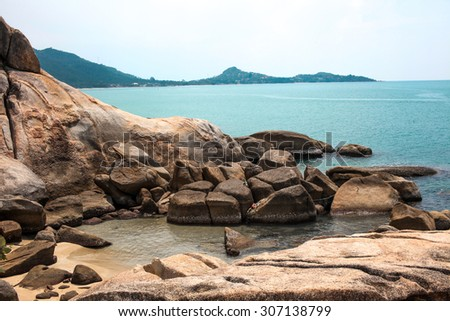 Full of rocks on the coast and Idyllic blue sea and clear sky. Taken in Koh Samui, Thailand - stock photo