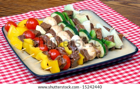 Full platter of marinated shish kabobs of meat and vegetables. - stock photo