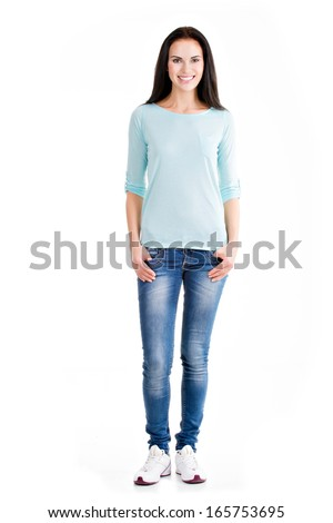 Full portrait of a beautiful young happy woman standing over white background - stock photo