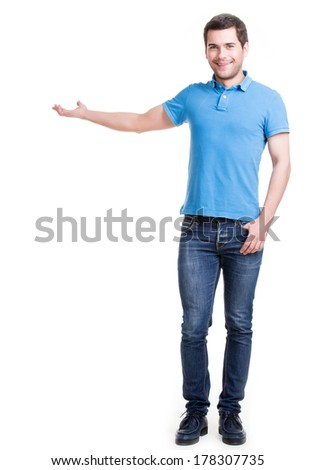 Full portrait of a smiling man shows something on palm -  isolated on white. - stock photo