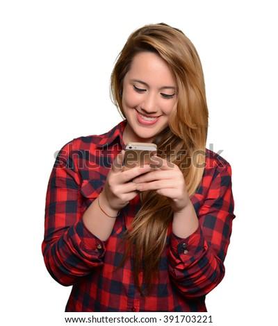 Full portrait of beautiful caucasian blonde girl using phone - stock photo