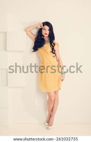 Full portrait of beautiful young sexy woman with long black curly hair  - stock photo