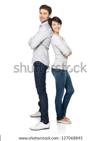 Full portrait of happy couple isolated on white background. Attractive man and woman being playful. - stock photo