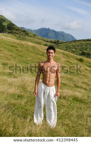 Full portrait of muscular young man doing yoga exercise