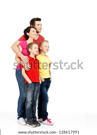 Full portrait of the happy young family with two children looking up isolated on white background - stock photo