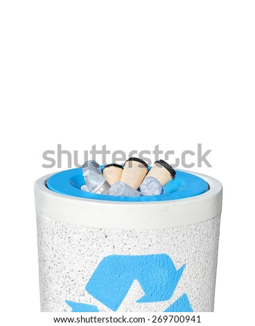 Full recycle bin filled to the top with empty plastic water bottles and paper coffee cups. Heavy rough texture stone trash can with blue recycling logo. Isolated on a white background with copy space  - stock photo