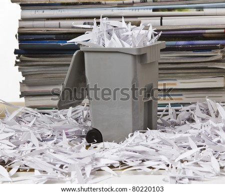 Full recycle bin with stacks of magazines as back ground - stock photo