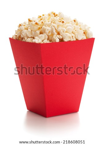 Full red bucket of popcorn, isolated on the white background, clipping path included. - stock photo