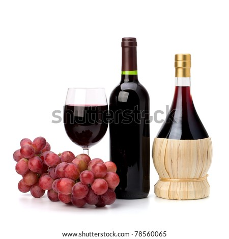 Full red wine glass goblet, bottle and grapes isolated on white background