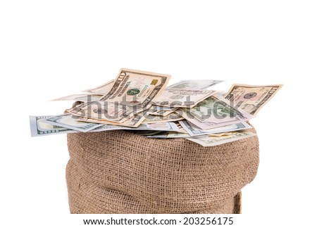 Full sack with dollar bills. Isolated on a white background. - stock photo