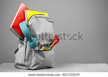 Full school backpack on grey background