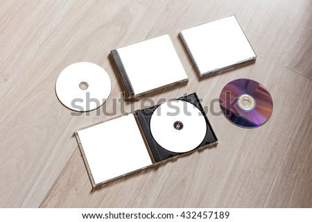 Full set compact disc template with plastic box case with white isolated blank for branding design and open box with booklet and back side. CD jewel case mock up with clean free space on wooden table. - stock photo