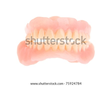 full set of a acrylic denture isolated on white background