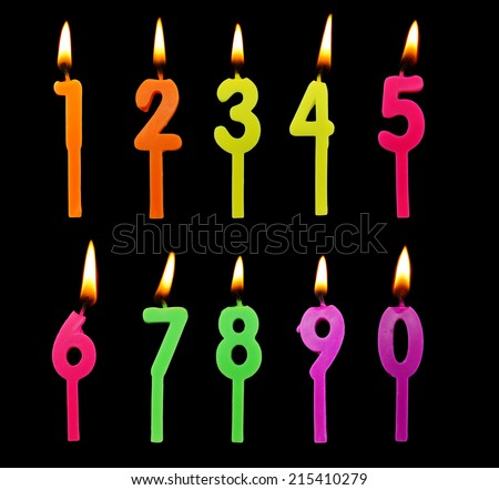 Full set of birthday candles on black background - stock photo