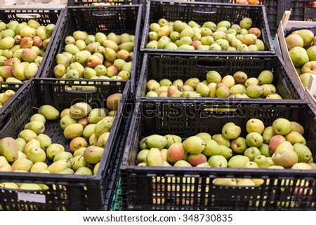 Full shells with pears in supermarket. World consumption problem. - stock photo