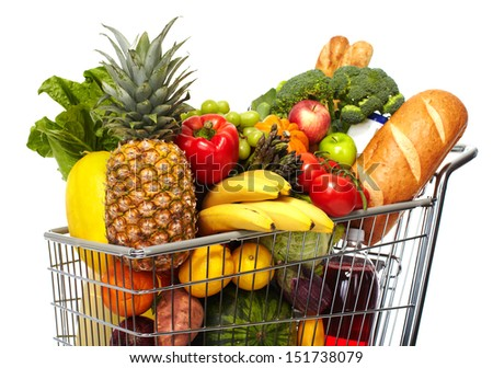 Full shopping grocery cart. Isolated on white background. - stock photo