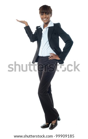 Full shot of female executive posing with copy space isolated over white background - stock photo