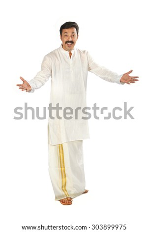 Full shot of happy Indian  man showing some action with his hands. - stock photo