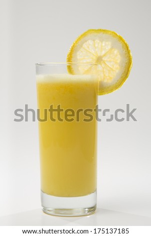 Full shot of orange juice in a glass isolated on white background