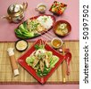 Full table setting of Asian chicken skewers with short soup and vegetables. - stock photo