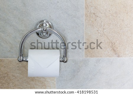 Full toilet paper in luxury chrome, luxury bathroom interior decor.  - stock photo