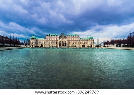 Full view of a baroque Upper Palace in historical complex Belvedere, Vienna, Austria with cloudy sky. It is a popular touristic attraction with famous museum and beautiful park with pond - stock photo