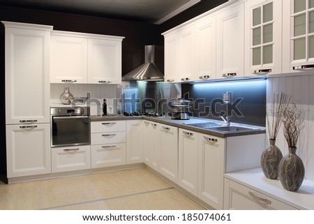 Full view of a modern kitchen cream colored - stock photo