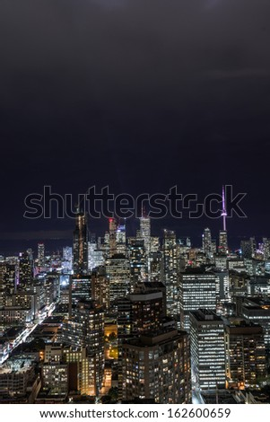 Full view of downtown Toronto at night with glamour lights