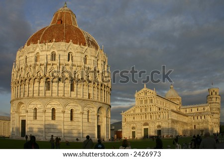 Full view of Piazza dei Miracoli, with the Baptistery in Foreground, followed by the Cathedral and the famous Bell Tower / Leaning Tower of Pisa.
