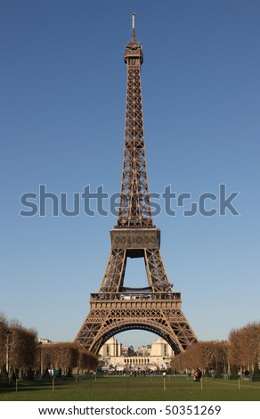 Full view of the Eiffel Tower in Paris with deep blue sky - stock photo