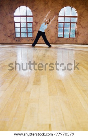Full view of woman stretching - stock photo