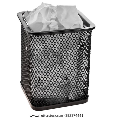 Full wire mesh trash can with crumpled paper isolated on white background - stock photo