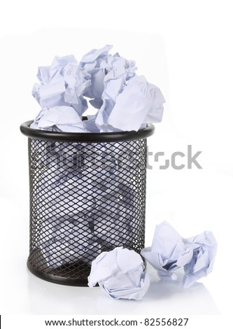 Full wire mesh trash can with crumpled paper scattered around. isolated on white - stock photo
