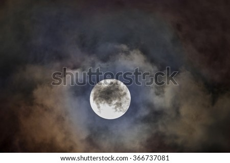 Full Wolf Moon with vivid clouds