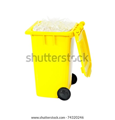 full yellow recycling bin with plastic - stock photo
