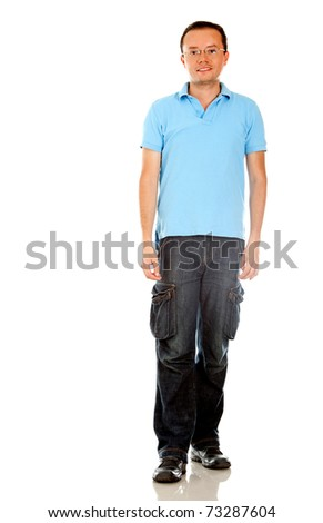 Fullbody casual man smiling � isolated over a white background