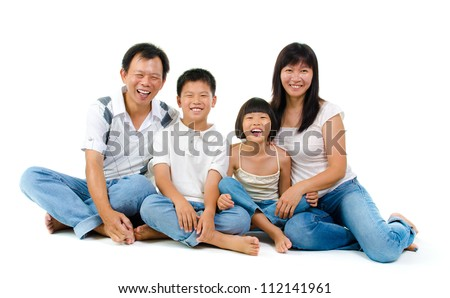 Fullbody happy Asian family sitting on white background - stock photo