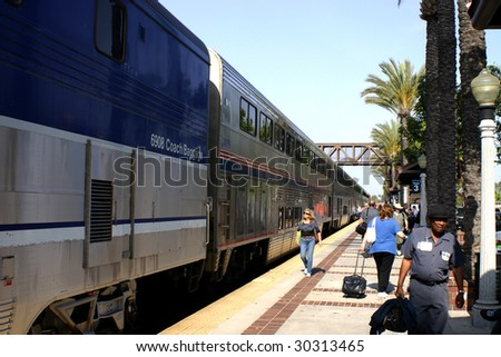 FULLERTON, CA- MAY 15: Passengers board a Surfliner regional train in the heavily trafficked Los Angeles region and California coast area, where trains compete with freeways May 15, 2009 in Fullerton. - stock photo