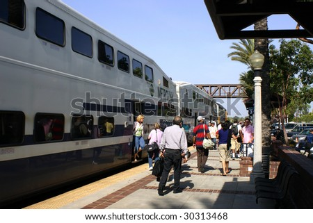 FULLERTON, CA - MAY 15:  Passengers exit a MetroLink train in the heavily trafficked Los Angeles region where trains compete with freeways May 15, 2009 in Fullerton. - stock photo