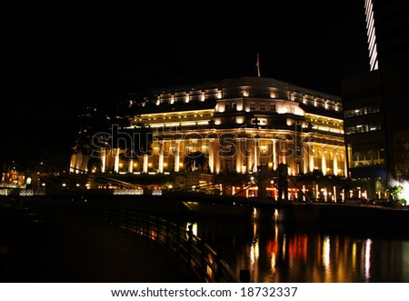 Fullerton hotel at night in Singapore