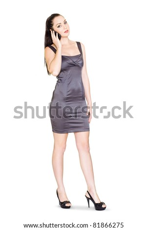 Fully Body Isolate Portrait Of An Attractive Female Business Sales Rep Communicating With Customers On A Mobile Phone During A Business Teleconference, On White - stock photo