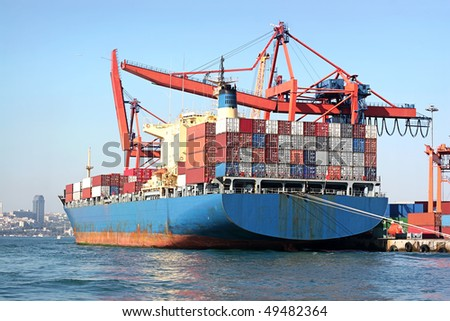 Fully loaded, blue cargo ship - stock photo