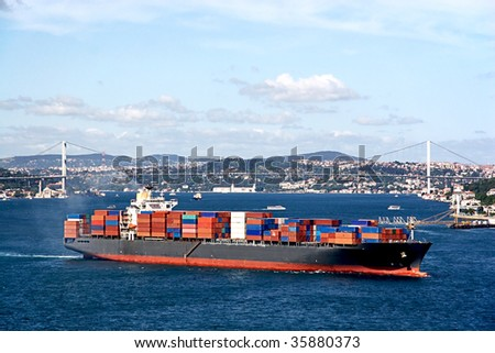 Fully loaded container ship moving through Bosprus - stock photo